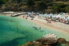 Kassiopi Beach, Corfu Island, Greece. Sunbeds and parasols (sun Stock Photo