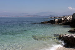 Kassiopi beach. Picturesque seaview. View of Albania. Turquoise waters of Adriatic sea. Kassiopi beach, Corfu Stock Images