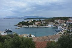 Kassiopi harbour, Corfu, Greece. The picturesque fishing village of Kassiopi in the north east of Corfu. This view is taken from the castle overlooking the stock image