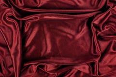 Kastanjebruine van de het Fluweeldoek van de Satijnzijde de Stoffenachtergrond Royalty-vrije Stock Afbeeldingen
