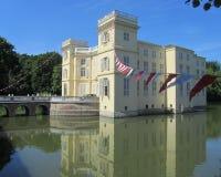 Kasteel dUrsel, Hingene, Belgium. HINGENE, BELGIUM, JUNE 6 2014: The beautiful water surrounded dUrsel Castle in Hingene. The castle provides the backdrop for Stock Photography