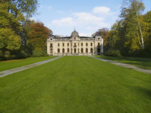Kasteel van Edingen (Enghien). Castle in Belgium with green field and trees Stock Photo