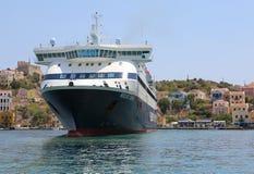 Hellenic Seaways Ferry docked to pick up new passengers. KASTELLORIZO,GREECE-AUGUST 10:Hellenic Seaways Ferry docked to pick up new passengers at the port royalty free stock image