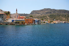 Kastellorizo-Megisti Greece. Τhe Harbor entrance with the old mosque Royalty Free Stock Photography