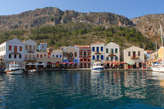 Kastellorizo-Megisti Greece. Τwo and three storey traditional houses in port Stock Image