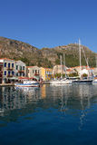 Kastellorizo-Megisti Greece. Τwo and three storey traditional houses in port Royalty Free Stock Images