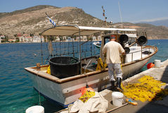 Kastellorizo-Megisti Greece. Fisherman in the small harbor Kastellorizo Royalty Free Stock Photography