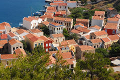 Kastellorizo-Megisti Greece. Structuring of the houses behind the harbor Royalty Free Stock Images
