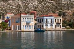 Kastellorizo-Megisti Greece. Two storey houses in front of the port Royalty Free Stock Image