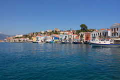 Kastellorizo-Megisti Greece. Two storey houses with tiled roofs harbor front Stock Photography