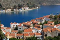 Kastellorizo-Megisti Greece. Traditional houses unfold along the shoreline Royalty Free Stock Images