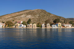 Kastellorizo-Megisti Greece. Traditional houses unfold to in front of the port Stock Images