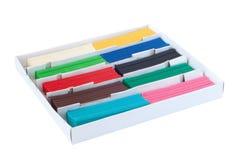Kasten mit Stücken farbigem Plasticine Stockbild