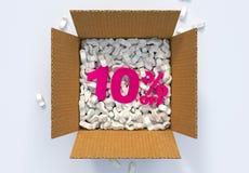 Kasten mit Versanderdnüssen und 10 Prozent heruntergesetzt -zeichen Stockbilder
