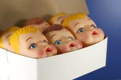 Kasten Puppe-Gesichter Stockbild