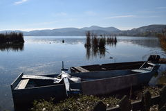 Kastoria lake with tranditional boat. Royalty Free Stock Images