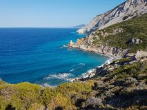 Kastro beach skiathos greece. Landskape with beautiful beach with blue and emerald water and steep cliffs royalty free stock photo
