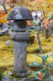 Kasuga doro or stone lantern in Japanese maple garden during autumn at Enkoji temple, Kyoto, Japan.  Royalty Free Stock Photos