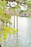 Kasumiga Ike pond and Uchihashi house in Kenroku-en park Royalty Free Stock Photos