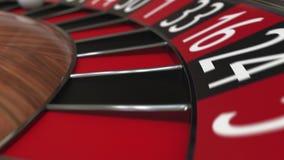 Kasynowa ruletowego koła piłka uderza 9 dziewięć czerwień zdjęcie wideo