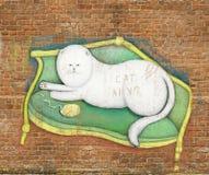 Kat op een bank Stock Foto