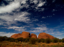 Kata Tjuta. In sun, red, with blue cloudy sky royalty free stock photo