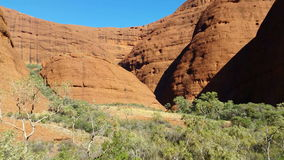 Kata Tjuta The Olgas Australian Landmark Outback Red Desert Landscape. Kata Tjuta, The Olgas also known as Mount Olga, are a group of large domed rock formations stock footage
