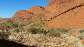 Kata Tjuta The Olgas Australian Landmark Outback Red Desert Landscape 4k. Kata Tjuta, The Olgas also known as Mount Olga, are a group of large domed rock stock video footage