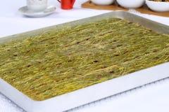 Kataifi - Traditional Turkish Dessert. Kanafeh Arabic, kadayıf Turkish, kadaif Albanian, kataifi, kadaifi Greek, is a very fine vermicelli-like pastry used to Stock Photo