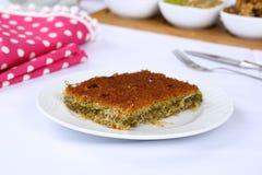 Kataifi - Traditional Turkish Dessert. Kanafeh Arabic, kadayıf Turkish, kadaif Albanian, kataifi, kadaifi Greek, is a very fine vermicelli-like pastry used to Royalty Free Stock Photo