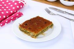 Kataifi - Traditional Turkish Dessert. Kanafeh Arabic, kadayıf Turkish, kadaif Albanian, kataifi, kadaifi Greek, is a very fine vermicelli-like pastry used to Stock Photography