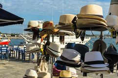 KATAKOLO, GREECE - October 31, 2017: Men`s and women`s braided straw hats for sale on the Catacolon promenade stock photo