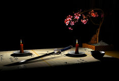 Katana. The image katana and candles Royalty Free Stock Photography