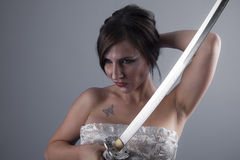 katana, beautiful brunette girl with a Japanese sword in aggress Royalty Free Stock Photo