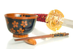 Katana, Chopsticks and bowl over white Stock Photo