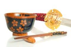 Katana, Chopsticks and bowl over white Stock Photo