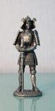 Katana del samurai de la estatuilla Imágenes de archivo libres de regalías
