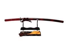 Katana Japanese-zwaard op zwarte tribune Royalty-vrije Stock Foto's