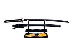 Katana Japanese-zwaard op zwarte tribune Stock Foto's