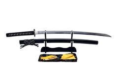 Katana Japanese-zwaard op zwarte tribune Stock Afbeeldingen
