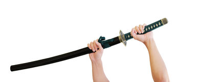 Katana Sword. Hands holding katana - japanese sword (Samurai sword Royalty Free Stock Image
