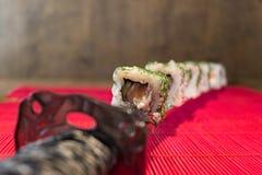Katana und Sushi Lizenzfreies Stockfoto