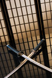 Katana and wakizashi with naked Royalty Free Stock Photography