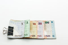 Katar-Währungen hundert Riyal, fünfhundert Riyal, hundert Riyal, fünfzig Riyal, zehn Riyal, fünf Riyal und ein Riyal Lizenzfreie Stockfotos