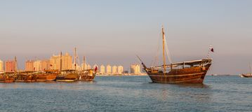 Katara beach Qatar traditional wooden boats dhow Royalty Free Stock Images