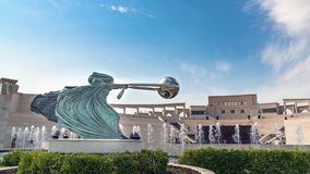 Katara Cultural village with statue in foreground and the Amphitheater in the background, Doha, Qatar stock images