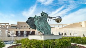 Katara Cultural village with statue in foreground and the Amphitheater in the background, Doha, Qatar royalty free stock photography