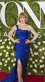 Kate Baldwin. Luscious redhead Kate Baldwin turns heads as she arrives on the red carpet at the 71st Annual Tony Awards to celebrate the best of Broadway royalty free stock photo