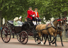 Kate, Duchess of Cambridge, in an open carriage. London, England - June 13, 2015: Kate, Duchess of Cambridge, in an open carriage with Camilla, Duchess of Stock Photos