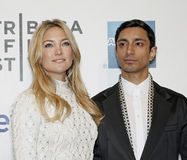 """Kate Hudson and Riz Ahmed. Hollywood film star Kate Hudson and actor Riz Ahmed arrive on the red carpet for the premiere of """"The Reluctant Fundamentalist,"""" Royalty Free Stock Photography"""